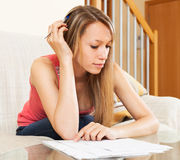 Tired woman studying notes Royalty Free Stock Images