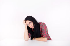 Tired woman at table Royalty Free Stock Image