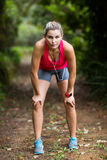Tired woman taking a break while jogging Royalty Free Stock Photos