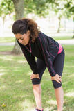 Tired woman taking a break while jogging in park Royalty Free Stock Photography