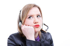 Tired Woman with telephone headset Royalty Free Stock Images