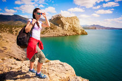 Tired woman tourist on the mountain's top Royalty Free Stock Image