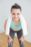 Tired woman with towel around neck at fitness studio royalty free stock photos