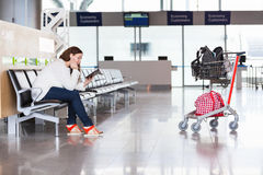 Tired woman waiting flight in airport lounge Stock Photo