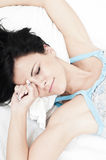 Tired woman waking up Stock Images