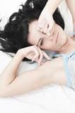 Tired woman waking up. Beautiful tired woman waking up without wanting it and looking still sleepy and dreamy Stock Photos