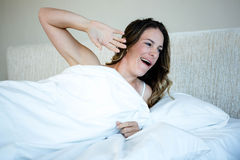 tired woman waking up and yawning Royalty Free Stock Photo