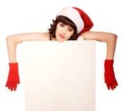 Tired woman wearing santa hat Stock Photo