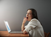 Tired woman working with laptop Royalty Free Stock Photography
