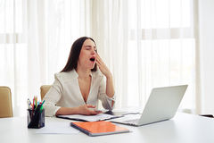 Tired woman working in the modern spacious office Stock Image