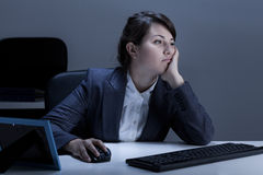 Tired woman working in the office Stock Image