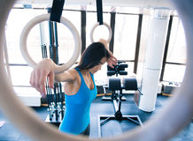 Tired woman working out on gimnastick rings Royalty Free Stock Images