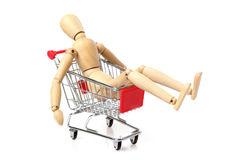 Tired Wood Man in a shopping cart Royalty Free Stock Images