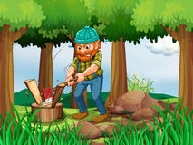 A tired woodman chopping the woods in the forest Stock Photo