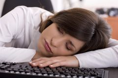 Tired at work. Beautifull business woman tired at work Royalty Free Stock Image