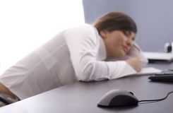 Tired at work Stock Images
