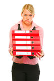 Tired of work female manager with pile of folders Royalty Free Stock Photos