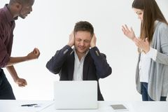 Tired from work or noise businessman closing ears with hands. Not to hear claims of annoying complaining clients, exhausted manager avoids bad work, suffers royalty free stock photography