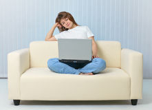 Tired after work woman reads with laptop Stock Photography