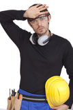 Tired worker. With helmet - isolated on white background Royalty Free Stock Images