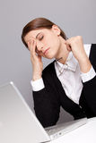 Tired worker. Tired lady sitting in the studio Royalty Free Stock Photos