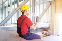 Tired worker on building site is having a break Stock Photos