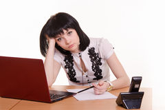 Tired worker call-center front of monitor, leaned her head on Royalty Free Stock Image