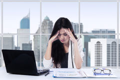 Tired worker doing job in office royalty free stock image