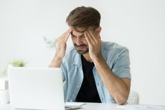 Free Tired Worker Massaging Head Suffering From Headache Royalty Free Stock Image - 117973336