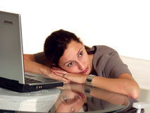 Tired of working. Working Woman with notebook PC resting on table and thinking Royalty Free Stock Photo