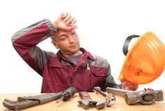 Tired working man with tools Royalty Free Stock Photography