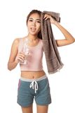 Tired Workout Asian girl with bottle of water and towel Royalty Free Stock Image