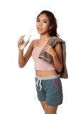 Tired Workout Asian girl with bottle of water and towel Stock Photography