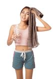 Tired Workout Asian girl with bottle of water and towel Royalty Free Stock Photography