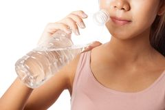 Tired workout asian woman drinking water Stock Images