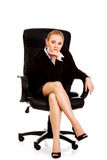 Tired or worried business woman sitting on armchair Royalty Free Stock Image