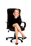 Tired or worried business woman sitting on armchair Royalty Free Stock Photo
