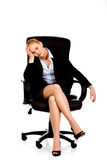 Tired or worried business woman sitting on armchair.  Royalty Free Stock Photos