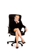 Tired or worried business woman sitting on armchair Stock Photos