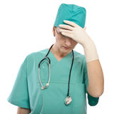Tired or worried female doctor Stock Photo
