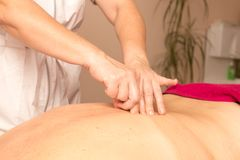 Therapeutic massage for the back Royalty Free Stock Photo