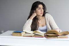 Tired and worried  young woman  studying for exams Stock Photography