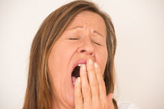 Tired yawning mature woman portrait Royalty Free Stock Photography