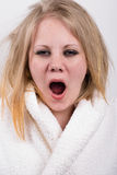 Tired yawning young woman with messy hair Royalty Free Stock Photo