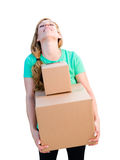 Tired Young Adult Woman Holding Moving Boxes Isolated On A White Stock Image