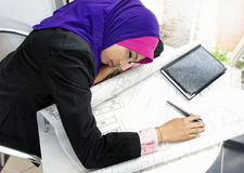 Tired young architect woman sleeping. While at work Stock Image