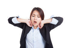 Tired young Asian businesswoman yawn Stock Images