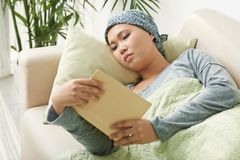 Cancer survivor reading book stock images