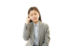 Tired young Asian woman Stock Images