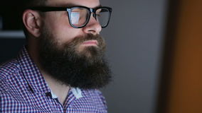 Tired young bearded man working at the computer stock video footage